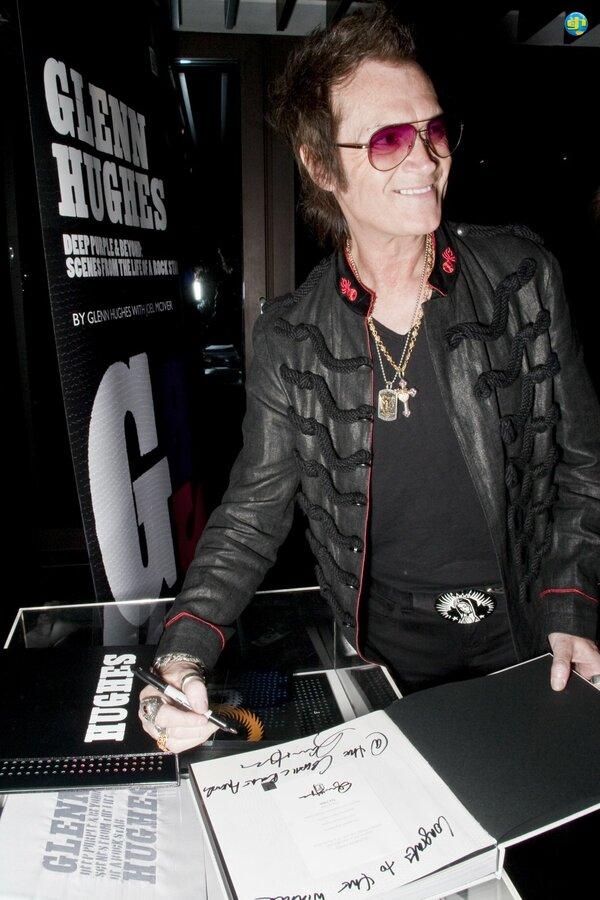 Glenn Autographs His Book